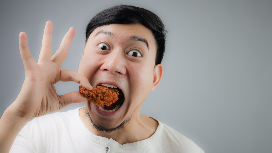 Assimilation: Asian Man eating fried chicken