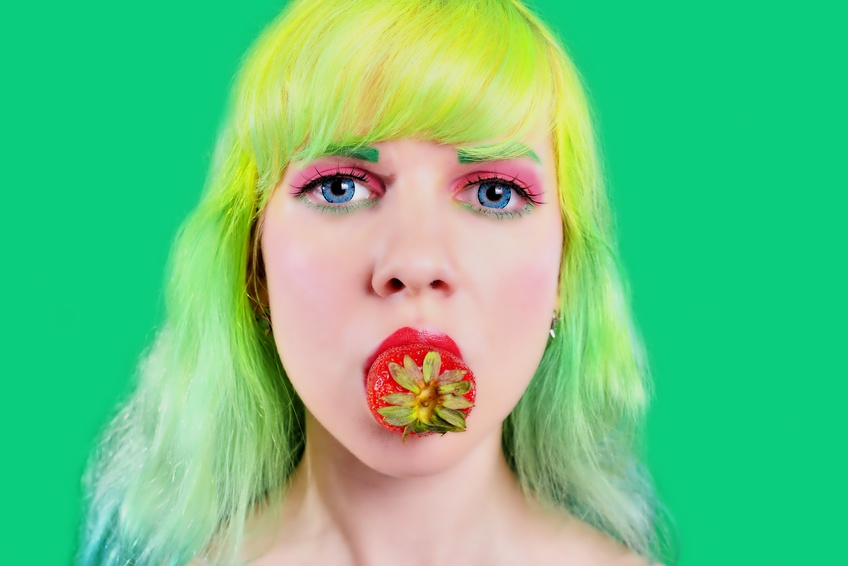 Blond girl eating strawberry food